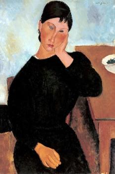 Amedeo Modigliani, Elvira appoggiata al tavolo.